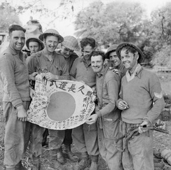 Royal Scots with a captured Japanese Hinomaru Yosegaki flag, Burma, 1945.