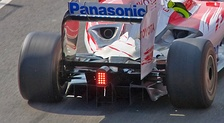 the rear of a Formula One car with a double decker diffuser located between the rear wheels