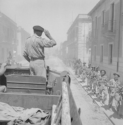 General Montgomery salutes his troops from a DUKW, Reggio, Italy, September 1943.