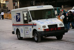 A United States Postal Service vehicle advertising its use of E85 fuel during the Saint Paul Winter Carnival parade in January 2007.