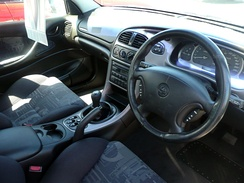 VX II Commodore SS interior with the satin dashboard veneer, sports-style upholstery and leather-wrapped steering wheel.