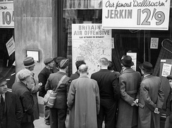 People in London look at a map illustrating how the RAF is striking back at Germany during 1940