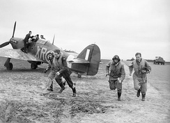 American pilots of No 71 'Eagle' Squadron rush to their Hawker Hurricanes at Kirton-in-Lindsey, 17 March 1941.
