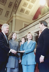Clinton being sworn in as U.S. Senator by Vice President Al Gore in 2000. Her husband Bill, and daughter Chelsea, are looking on.