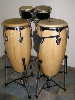 Front: A pair of congas. Back: A pair of bongos.