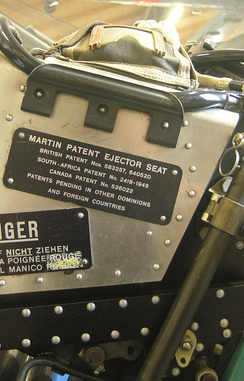 "The plate of the Martin ejector seat of a military aircraft, stating that the product is covered by multiple patents in the UK, South Africa, Canada and pending in ""other"" jurisdictions. Dübendorf Museum of Military Aviation."