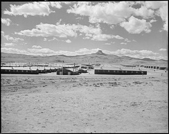 Heart Mountain, Wyoming. Looking west over the Heart Mountain Relocation Center with its sentry namesake, Heart Mountain, on the horizon. (NARA 538782)