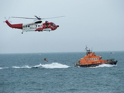A search and rescue demonstration by an Irish Coast Guard Sikorsky S-61 helicopter and a RNLI lifeboat.