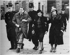 Jewish refugees being marched away by British police at Croydon airport in March 1939. They were put on a flight to Warsaw.