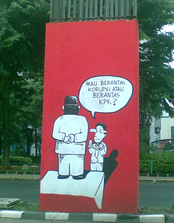 "A mural expressing support for KPK on a support pillar of the abandoned Jakarta Monorail. The caption reads ""do you want to eradicate corruption or eradicate the KPK?"