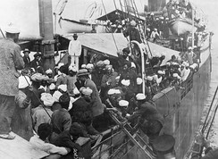 Punjabi Sikhs aboard the Komagata Maru in Vancouver's English Bay, 1914. The Canadian government banned the passengers from landing in Canada and the ship was forced to return to India. The events surrounding the Komagata Maru incident served as a catalyst for the Ghadarite cause.