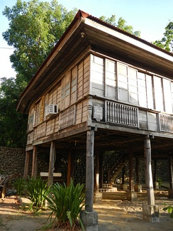 Bahay kubo elevated through wooden posts