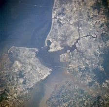 Newport News, Hampton, Isle of Wight County, Suffolk, Chesapeake, Portsmouth and Norfolk, Virginia from space, July 1996. Norfolk is located in the upper right quadrant, and east is at the top.