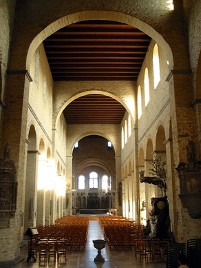 St Gertrude, Nivelles, Belgium, (consecrated 1046) has a nave and aisles divided by piers supporting a clerestorey. The nave is divided by transverse arches. The interior would have been plastered and painted.