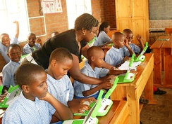 Children in a Rwandan primary school, using laptops supplied by the One Laptop Per Child scheme