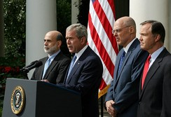 Cox, Hank Paulson, and Ben Bernanke watch as President George W. Bush delivers a statement on the economy in 2008