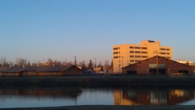 TCC main campus in downtown Fairbanks, with the Chena River in the foreground.