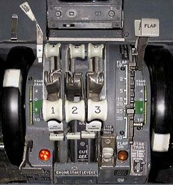 The thrust levers of a three-engine Boeing 727, each one bearing the respective engine number