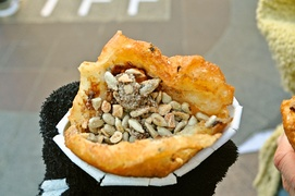 Hotteok (a variety of filled Korean pancake) with edible seeds, sugar, and cinnamon
