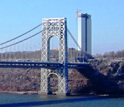 The George Washington Bridge, connecting Fort Lee (above) in Bergen County across the Hudson River to New York City, is the world's busiest motor vehicle bridge.[176][177] One of two 47-story residential skyscrapers, to be Bergen County's tallest, is seen under construction near the gateway to the bridge in December 2013.[175]