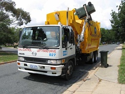 A recycling truck collecting the contents of a recycling bin in Canberra, Australia