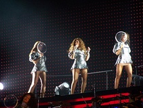 "Knowles performing ""Independent Women"" with her female background dancers (left) and ""Upgrade U"" with several male background dancers (right). Her dancing abilities during the shows of the tour received praise from critics."
