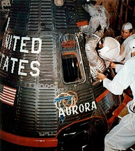 Carpenter is helped into his Aurora 7 spacecraft on May 24, 1962.