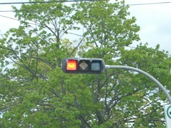 A traffic signal in Halifax, Nova Scotia, with specially shaped lights to assist people with colour blindness