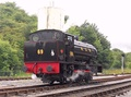 Hunslet Austerity 0-6-0ST 'Norman' in disguise as NCB No. 69 takes on water from the water tower at Bolton Abbey