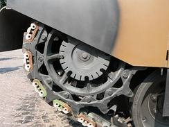 A sprocket wheel on a tank