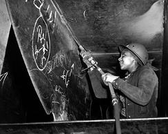 Eastine Cowner, a former waitress, at work on the Liberty ship SS George Washington Carver at the Kaiser shipyards, Richmond, California, in 1943. One of a series taken by E. F. Joseph on behalf of the Office of War Information documenting the work of African-Americans in the war effort.