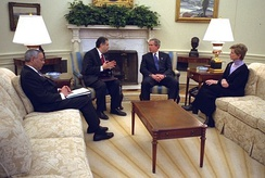 Whitman in a meeting with President George W. Bush, Colin Powell, and Spencer Abraham in February 2003