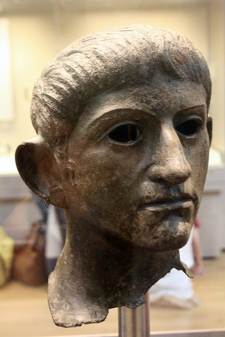 Bronze head of Claudius found in the River Alde at Rendham, near Saxmundham, Suffolk (British Museum). Potentially taken from the Temple of Claudius in Colonia Victricensis during the Boudican revolt.[20]