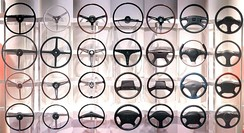 Passenger car steering wheels from different periods