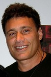 Robert Loggia (left) and Steven Bauer (right), who respectively played Frank and Manny in the original film, both returned to voice characters in the game. Loggia voices several civilians and narrates the game. Bauer voices The Sandman and one of the Diaz brothers.