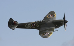 Supermarine Spitfire with 20 mm cannon protruding from the leading edge of the wing