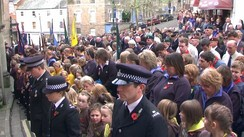 Scouts, Brownies, and Cubs with the local community in Tiverton, Devon on Remembrance Sunday