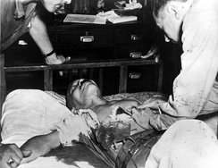 Japanese general Hideki Tojo, receiving treatment immediately after attempted suicide, 1945