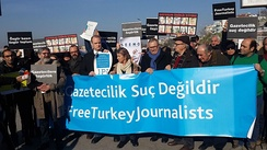 Turkish journalists protesting the imprisonment of their colleagues on Human Rights Day in 2016.