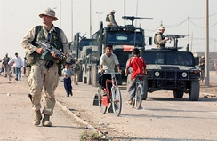 US Marines patrol the streets of Al Faw, October 2003.