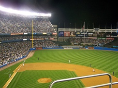 Picture of old Yankee Stadium showing its left field fence, which was famous for being farther than the right.