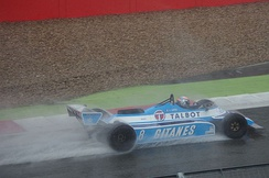 A JS17 being driven in the rain at Silverstone in 2015.