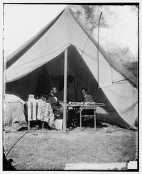 Abraham Lincoln and George B McClellan in the general's tent, Oct 1862.jpg