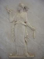 Atropos cutting the thread of life. Ancient Greek low relief.