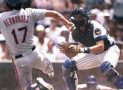 Hernandez (left) sliding home with the Mets