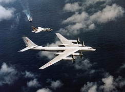 An F-8 of Oriskany intercepts a Tu-95 'Bear-B'.