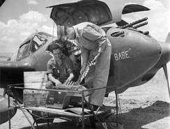 Pilot and aircraft armorer inspect ammunition for the central 20 mm cannon