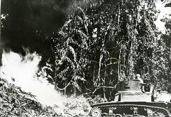 An M3 Stuart, fitted with a flamethrower, attacks a Japanese bunker during the Bougainville Campaign (April 1944)