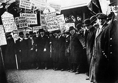 Garment workers on strike in New York City holding multilingual signs, including in Russian, circa 1913