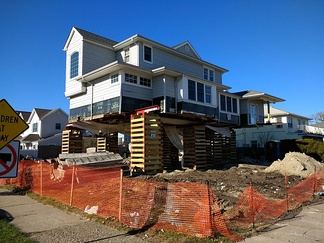 In Long Beach, New York, five years after the storm, homes are still being raised—lifted on temporary pilings so that permanent foundations could be put in.